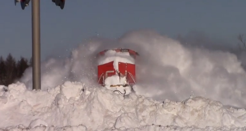 Train ploughs through snow